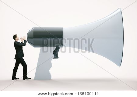 Small businessman screaming into huge megaphone on white background. 3D Rendering