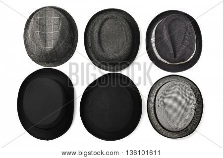 high-angle shot of different hats on a white background