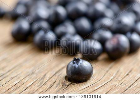closeup of a pile of appetizing ripe blueberries on a rustic wooden table