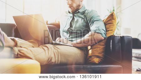Stylish Hipster working Laptop modern Interior Design Loft Office.Man work Retro Sofa, Use contemporary Notebook, typing keyboard.Visual Effect Background.Creative Business Startup Idea.Horizontal, Film