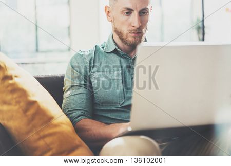 Bearded Hipster working Laptop modern Interior Design Loft Office.Man Work Coworking Place, Use contemporary Notebook, typing keyboard.Blurred Background.Creative Business Startup Idea.Horizontal, Film