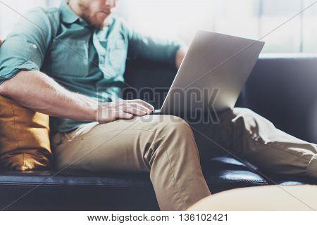 Bearded Banker working Laptop modern Interior Design Loft Studio.Man sitting Vintage chair.Use contemporary Notebook, blurred background.Creative Process New Startup Idea.Horizontal, film effect