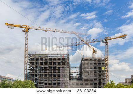 Construction Cranes At Big Building Construction Site