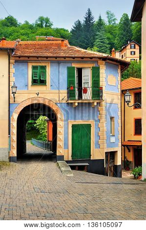 Fabulous colorful house with an arch in the Italian court yard