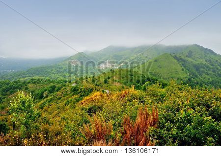 Autumn mountain landscape with fog in Italy