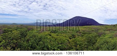 Active volcano Cerro Negro near the city of Leon in Nicaragua. Panorama of several frames