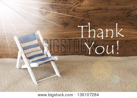 Sunny Summer Greeting Card With Sand And Aged Wooden Background. English Text Thank You. Deck Chair For Holiday Or Vacation Feeling.