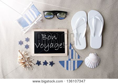 Flat Lay Of Chalkboard On Sandy Background. Sunny Summer Decoration As Holiday Greeting Card. Sand And Beach Environment. French Text Bon Voyage Means Good Trip