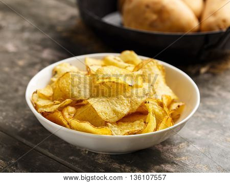 Hearty kettle cooked potato crisps served in a bowl.