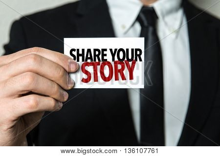 Business man holding a card with the text: Share Your Story