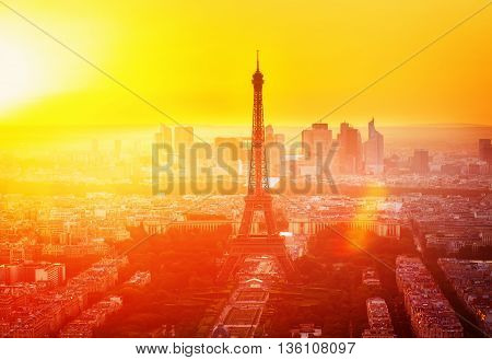 Eiffel Tower and Paris cityscape from above in orange sunset sunlight, France, retro toned