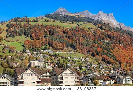 Engelberg, Switzerland - 12 October, 2015: view on the town with mountains in the background. Engelberg is a resort town and municipality in the Swiss canton of Obwalden.