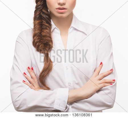 Closeup portrait of woman with her arms crossed or folded over white background. Female with hair braids style. Modern hairstyle in studio.