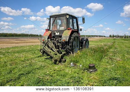 mowing the succulent grasses to feed cattle in a mechanized way