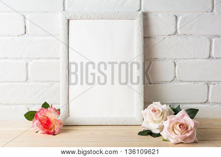White frame mockup with roses. Empty white frame mockup for design presentation. Portrait or poster white frame romantic style mockup