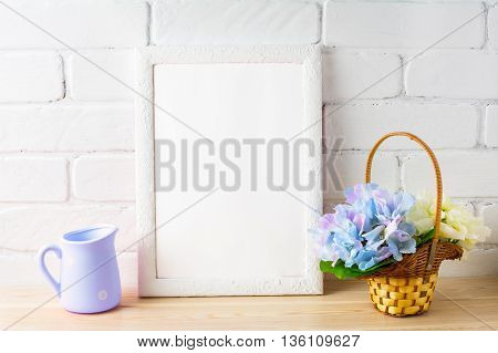 White frame mockup with flower basket. Portrait or poster white frame mockup. Empty white frame rustic style mockup for design presentation.