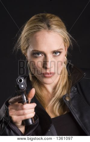 Sexy Blond With Gun In Leather Jacket