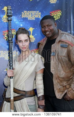 Brandon C. Jackson and an undidentified cosplayer arrive at the 42nd Annual Saturn Awards on Wednesday, June 22, 2016 at the Castaway Restaurant in Burbank, CA.