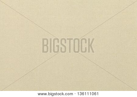 light beige background from a textile material. Fabric with natural texture. Cloth backdrop.