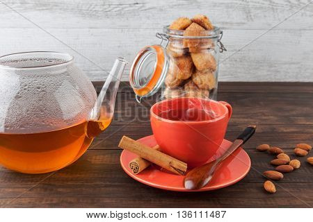 Hot Tea In Red Teacup With Cookies
