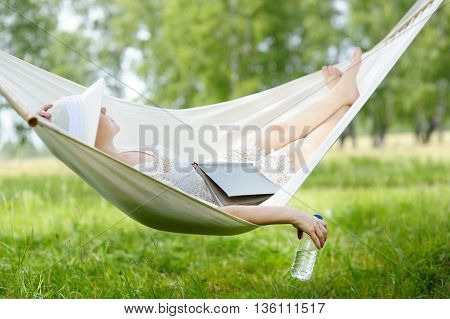 Woman Resting In Hammock