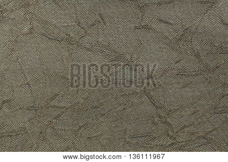 Olive green wavy background from a textile material. Fabric with natural texture closeup. Upholstery fabric pleated.