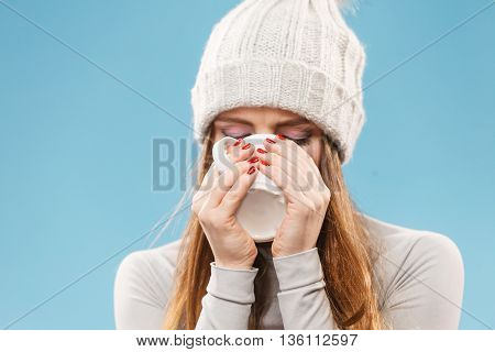 Woman In Winter Wool Cap Drinking Tea