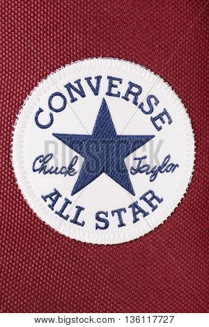 BREST BELARUS - JUNE 25 2016: Converse All Star Chuck Taylor label on a Red classic canvas sneakers