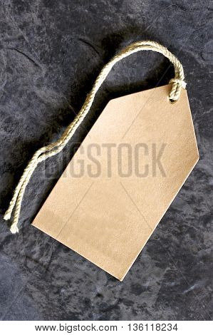 A brown retail shop pricing tag for indication of the cost of an item.