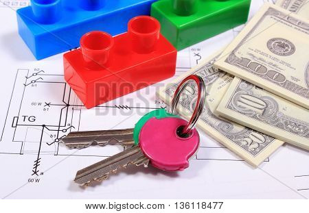 Heap of banknotes home keys and plastic colorful building blocks lying on construction drawing of house concept of building house
