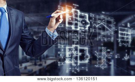Man engineer at work . Mixed media
