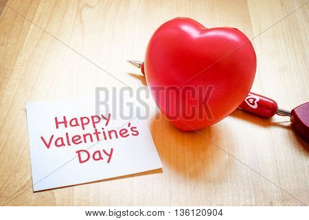 Notepad With Heart Toy And Red Pen On Wooden Table Happy Valentine's Day