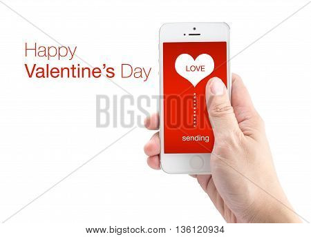 Hand Holding Smartphone With Sending Word And Heart Shape On Screen On White Background, Happy Valen