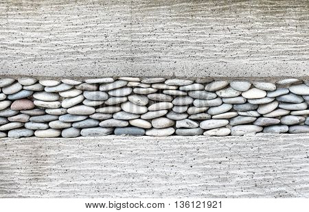 Wall layer with pebbles stone and cementTexture background.