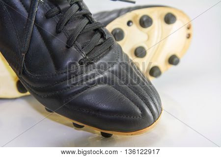 Selective focus to button of soccer shoes / Football shoes