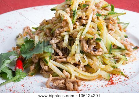 Traditional uzbek salad with meat and cucumber