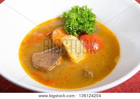Traditional central asian soup with meat and vegetables
