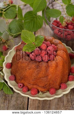 Cake with raspberries on a wooden background