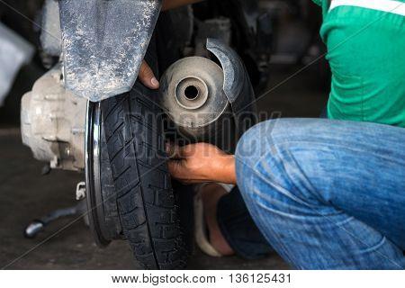 Motorbike tire replacement scene, installation in garage