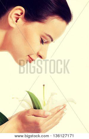 Beautiful woman holding lily flower.