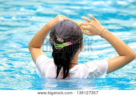 young girl in the swimming pool alone