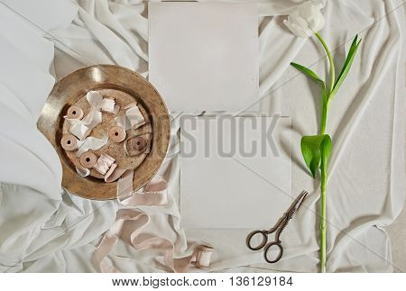 Vintage still life scissors, sewing, flower and card copy space