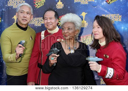 Nichelle Nichols, with cosplayers, arrives at the 42nd Annual Saturn Awards on Wednesday, June 22, 2016 at the Castaway Restaurant in Burbank, CA.