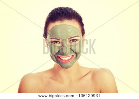 Beautifu toplessl woman with facial mask.