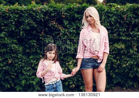 mom and daughter walk in the Park shirts