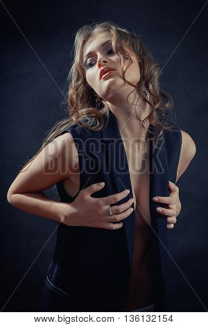 pretty sensual woman on black background toned image