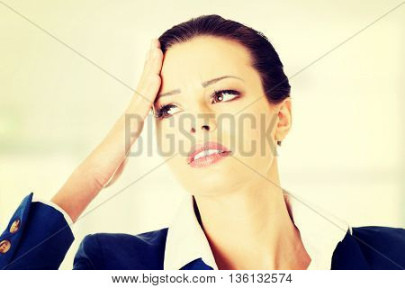Beautiful businesswoman is having a headache.