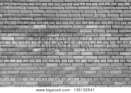 the brick textured background or wallpaper of abstract monochrome tone of gray color