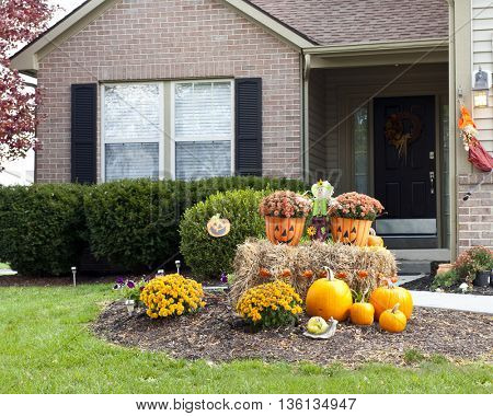 Happy and Colorful Halloween decorations welcoming visitors in front of a family home.