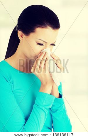 Young woman with tissue.